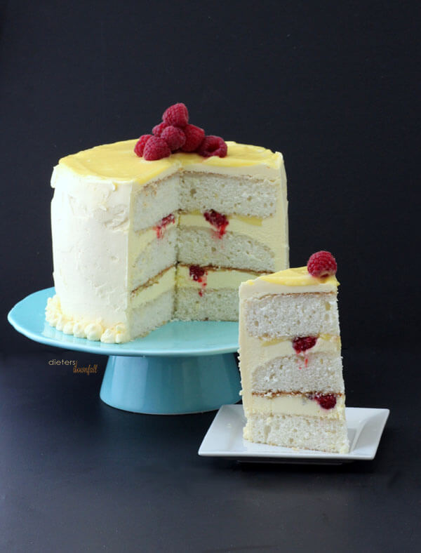 A three layer cake with raspberries and lemon flavors that will brighten up your day. from #DietersDownfall.com